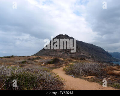 Sand trail at Kaena Point on the island of Oahu, Hawaii - Stock Photo