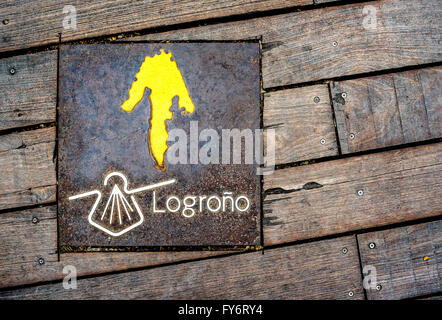 Sign of Way of St James (Camino de Santiago), placed on a wooden floor.