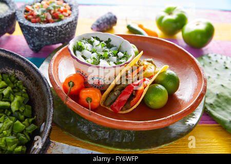 Nopal taco mexican food with chili pepper and ingredients on colorful table - Stock Photo