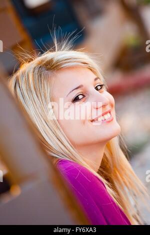 Portrait faceshoot womanportrait portraitwoman face eyes-contact eyescontact people smile smiling positive feeling - Stock Photo
