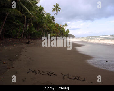 'Miss You' written in the sand on a remote beach in Punta Banco, Costa Rica on the Pacific Coast - Stock Photo
