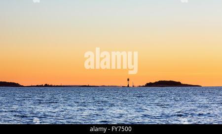 Sunrise seen from Bylandet island, the capitol of Finland (Helsinki) in the background, Kirkkonummi, Finland, Europe, - Stock Photo