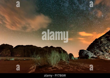 Milky way above red Wadi Rum desert in Jordan. - Stock Photo