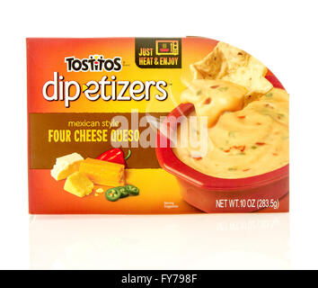 Winneconne, WI - 23 Dec 2015: Package of Totitos dipetizers mexican style in four cheese queso flavor. - Stock Photo