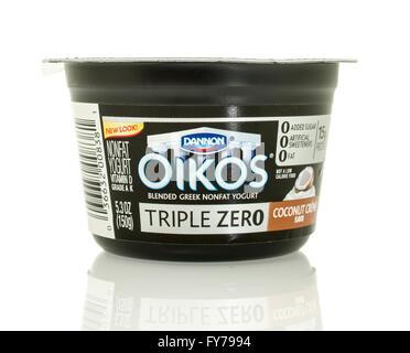 Winneconne, WI - 17 Jan 2016:  Container of Dannon Oikos Greek yogurt in coconut creme  flavor - Stock Photo