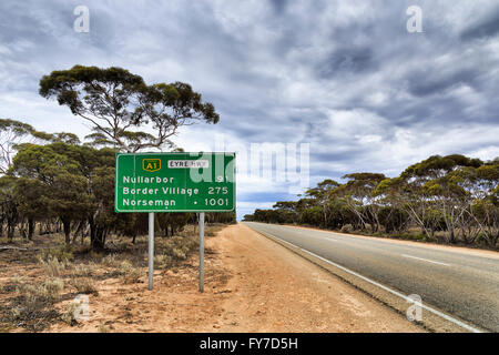 Green information road sign along National Eyre Highway A1 in South Australia somewhere in Nullarbor plain with - Stock Photo