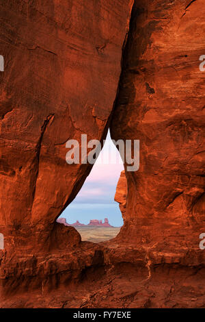 Sunset glow on Teardrop Arch in Utah's Monument Valley Tribal Park. - Stock Photo
