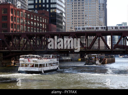 An architecture cruise ship and barge on the Chicago River under a CTA elevated train at the Lake Street Bridge - Stock Photo