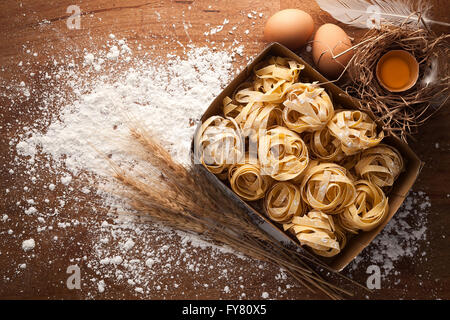 fettuccine pasta italian food still life rustic flat lay wood background tagliatelle alfredo  yolk - Stock Photo