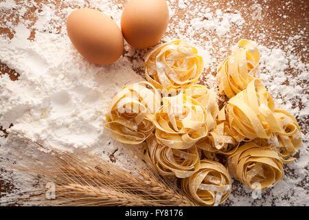 fettuccine pasta italian food still life rustic flat lay wood background tagliatelle alfredo close up macro - Stock Photo