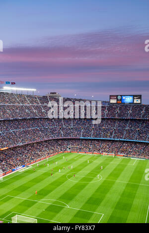 Camp Nou football stadium in Barcelona.Sunset is coloring clouds  making even better the overall view as we watch - Stock Photo