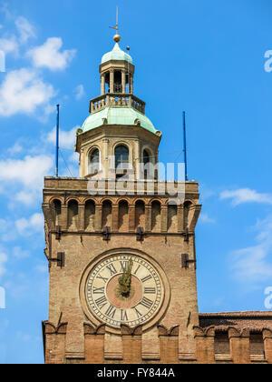 Clock tower of Palazzo d'Accursio town hall on Square Piazza Maggiore in Bologna, Emilia Romagna, Italy - Stock Photo