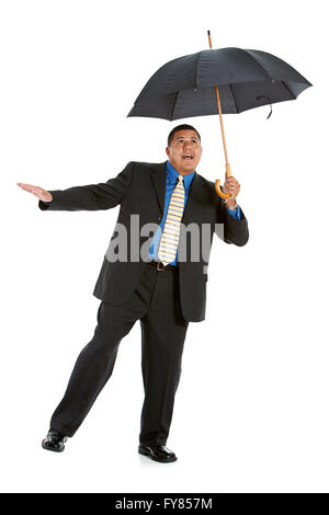 Series of a Hispanic businessman in suit, isolated on white, with props, in various poses. - Stock Photo