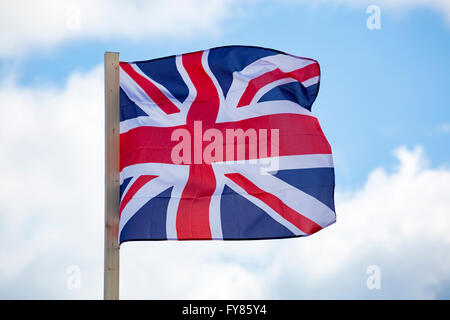 Union Jack flag blowing in the wind - Stock Photo