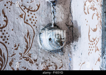 Close up of an old and worn vintage light switch. - Stock Photo