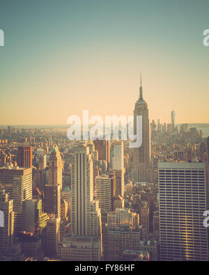View across New York City at midtown Manhattan at sunset with vintage tone and Empire State Building - Stock Photo
