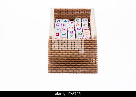 letter cubes placed in a box on a white background - Stock Photo