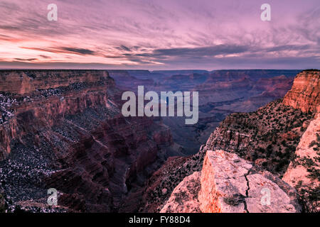 The rocks of the Grand Canyon reflecting the pink of the Arizona sunset - Stock Photo
