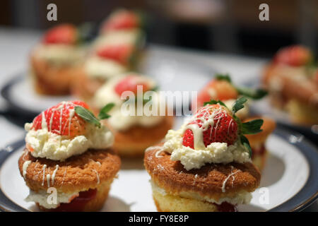 Homemade strawberry and cream cakes as part of a student baking project. - Stock Photo