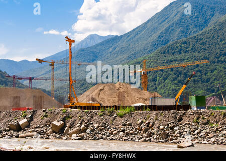 Construction site with construction equipment in the Caucasus Mountains. Sochi. - Stock Photo