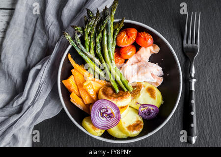 Lunch bowl with vegetables and salmon - Stock Photo