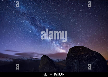 Milky way over ancient granite rocks - Stock Photo