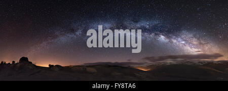 Spain, Milky way over mountains - Stock Photo