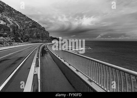 View of the magestic Sea Cliff Bridge and surrounding landscape of Grand Pacific Drive, Sydney, Australia. Black - Stock Photo