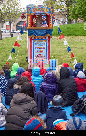Children and their parents watching traditional Punch and Judy hand puppets show, London England United Kingdom - Stock Photo