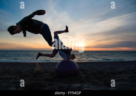 Aberystwyth Wales UK, Saturday 23 April 2016 UK weather: As the sun sets over Cardigan Bay in Aberystwyth at the - Stock Photo