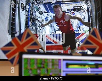 Cologne, Germany. 24th Apr, 2016. British astronaut Tim Peake is seen on a video screen transmitted from the International - Stock Photo