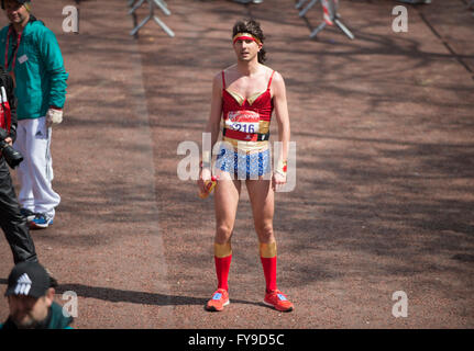 The Mall, London, UK. 24th April, 2016. 2016 Virgin London Marathon, Wonder Woman lookalike crosses the finish line. Credit:  sportsimages/Alamy Live News