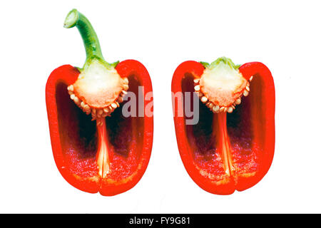 Cut half of a red pepper on a white background - Stock Photo