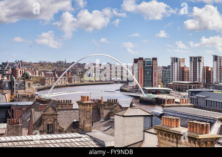 A view over the roof tops to the Gateshead Millennium Bridge, Tyne and Wear, England, UK - Stock Photo
