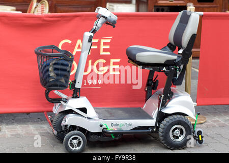 Quingo Flyte Mobility Scooter parked outside Café rouge - Stock Photo