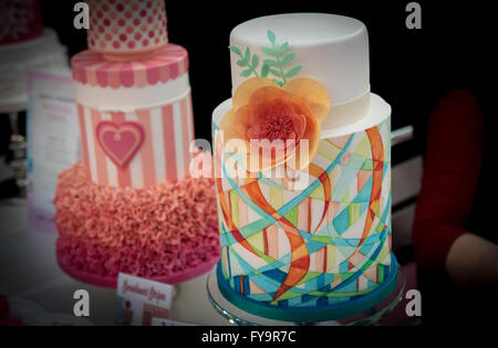 Floral and heart motive wedding cakes at Cake International – The Sugarcraft, Cake Decorating and Baking Show in - Stock Photo