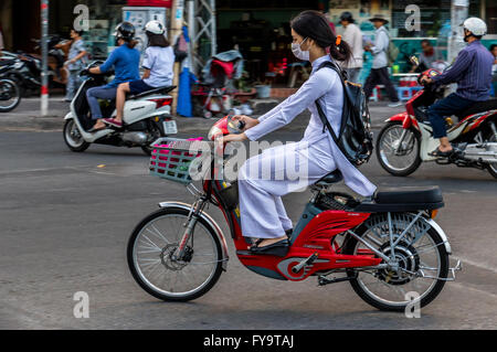 Lady In Hochi Minh City Vietnam On Motor Scooter Wearing