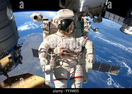 International Space Station and astronaut in outer space over the planet Earth. Elements of this image furnished by NASA.