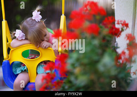 Little girl on a playground. Child playing outdoors in summer. Kids play on school yard. Happy kid in kindergarten - Stock Photo