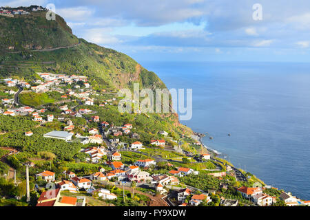 Landscape with Madeiran coastal village, Portugal - Stock Photo