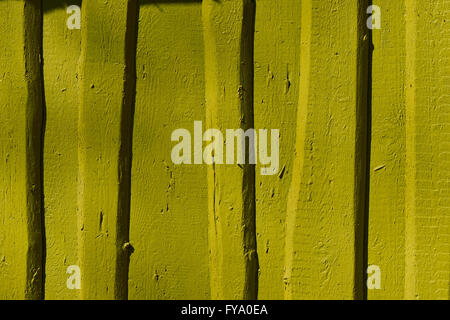 mustard color wall wooden fence - Stock Photo