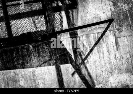 Rusty metal and broken wire fencing black and white monochrome abstract - Stock Photo