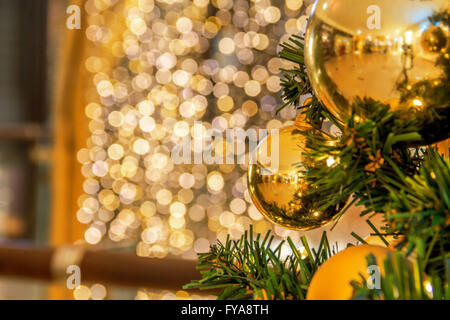 Christmas tree background with gold blurred light - Stock Photo