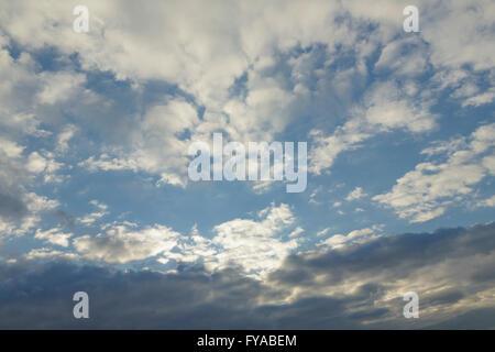 Stratocumulus and Altocumulus clouds - Stock Photo