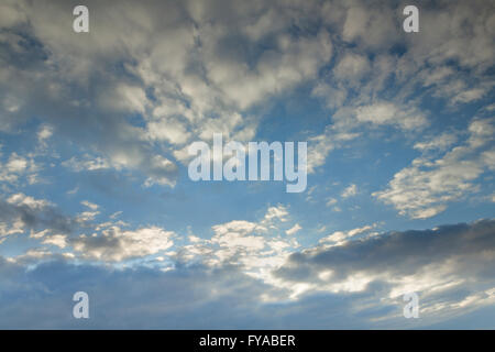Stratocumulus and Altocumulus clouds - Stock Photo