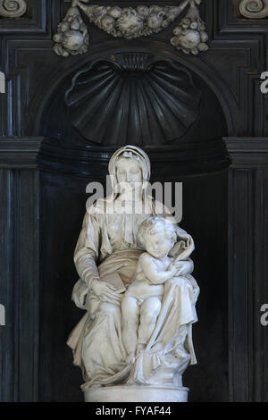 White marble statue of Madonna and Child (1504) created by Michelangelo at the Church of Our Lady in Bruges, Belgium - Stock Photo
