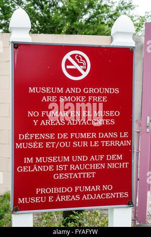Florida Big Cypress Seminole Tribe Indian Reservation no smoking sign multiple languages Spanish English French - Stock Photo