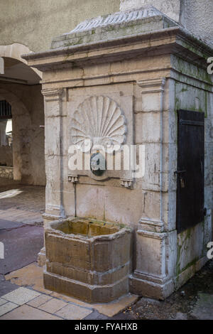 Drinking fountain in Annecy old town, Haute-Savoie, France, Europe. - Stock Photo