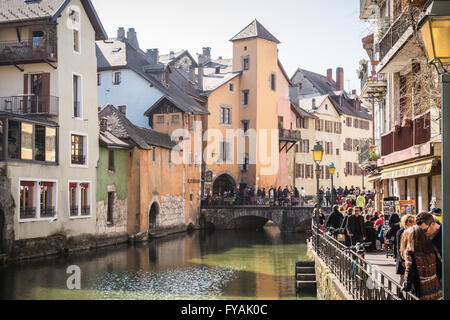 Tourists walking along the river bank in Annecy old town, Haute-Savoie, France, Europe. - Stock Photo