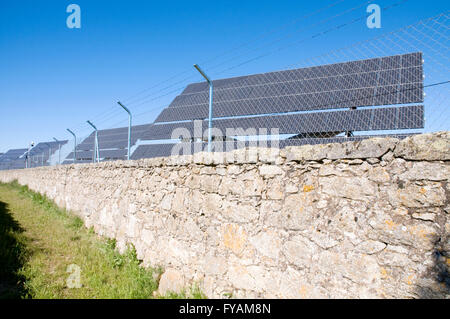 Solar panels behind wire fence. Solar energy production plant. Toledo province. Castile La Mancha. Spain. - Stock Photo